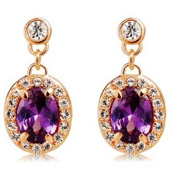 Rigant White Crystal Decorated Oval Shaped Earrings (Purple)